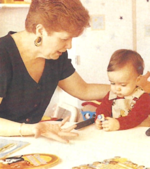 Mary Pat Moeller with baby in infant hearing