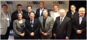 HIA Board Members include Jeff Newnham (Phonak), Rodney Schutt (Widex), Gordon Walker (Knowles Electronics), Todd Murray (GN ReSound), Peer Lauritsen (Oticon), Scott Davis (Siemens); Front Row L-R: Carole Rogin (HIA president), Robert Tong (ON Semiconductor), Jeff Taylor (Sonion), Jerry Ruzicka (Starkey), and Kevin Kouba (Rayovac).