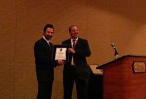 Ron Leavitt, AuD, is presented the Larry Mauldin Award by Beltone's Ken LaFerle