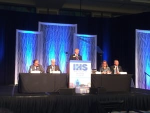 IHS President Scott Beall describes IHS's recent activities during the IHS Membership Meeting with (seated l to r) the Society's Secretary Antonio Calderon, MD, BC-HIS, President-elect Richard Giles, ACA, BC-HIS, Executive Director Kathleen Mennillo, and Treasurer Todd Beyer, ACA, BC-HIS.