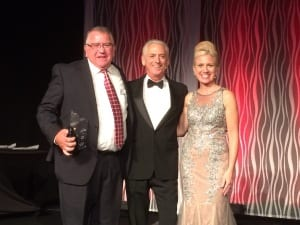 At the IHS Gala Dinner, Wayne Morris of the Oklahoma Hearing Assn was presented with the Society's James P. Lovell Award by Alan Lowell and Leanne Polhill.
