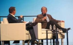 Starkey's Brandon Sawalich chats with President George W. Bush.