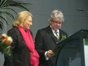 EUHA President Martin Blecker presents the EUHA Golden Badge of Honor—the organization's highest honor—to Inge Steinl, former the managing director of FGH and VHI (today BVHI).