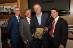 The HearStrong event included (l-r) Brian McCaskey, VP of the Chicago Bears Organization and HearStrong Foundation Board Member Ed Keller, founder of HearStrong Foundation and president of EarQ; Rasmus Borsting, Executive Director of Oticon Inc; and EarQ Senior VP Andrew Hebert.
