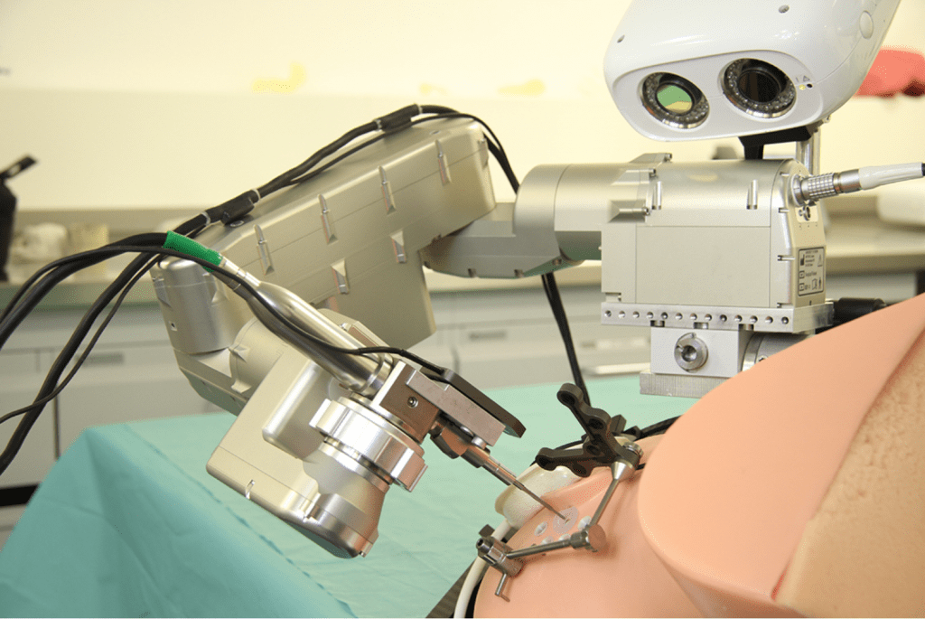 Robot aligned with entry trajectory on phantom head. © ARTORG Center for Biomedical Engineering Research, University of Bern.