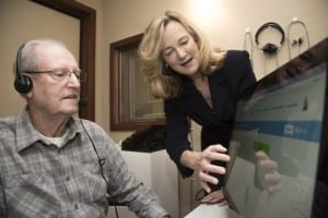 Nancy Tye-Murray, PhD, right, has developed training software to let patients with hearing loss practice listening to the voices they most want to hear. Tye-Murray helps Lonnie Willmann record audio clips for his wife, Kathleen Willmann, who has been diagnosed with hearing loss. Photo Credit: Robert Boston