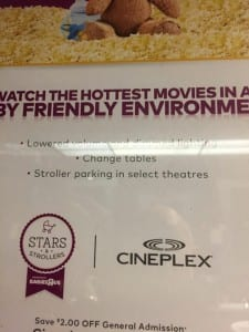 """Figure 1. This hastily snapped photo from my phone, taken over the hand-dryer in a theater bathroom, boasts that as part of its """"friendly environment"""" this movie features """"Lowered volume and dimmed lighting."""""""