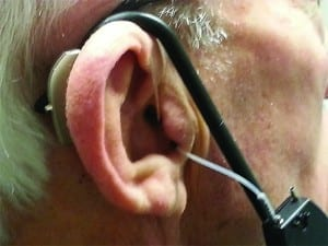 Figure 7. Measurement set-up with test hearing aid and probe tube in place.