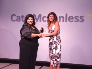 Membership & Marketing Manager Fran Vincent presents Kate McCandless with the James P. Lovell Award.