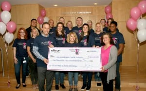"""Oticon President Gary Rosenblum celebrates success of the Oticon """"Hear in Pink"""" Campaign with the presentation of a check for $10,000 to National Breast Cancer Coalition Board Member Joy Simha."""