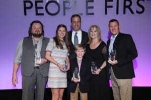(L-R) 2017 Oticon Focus on People Award winners: John Cartwright (Advocacy); Ellie Kobak (Student); Oticon President Gary Rosenblum; Marilyn Hinrichs, AuD (Practitioner); Lieutenant Commander Michael McManus, and front, Braden Baker (Outstanding Achievement).