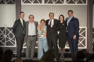 L to R: Mason Walker, President; Brandon Dawson, CEO; award winner and member Kate Tuomala; Mike Halloran, CFO; Misty Stern, EVP Operations and Marketing; and Connon Samuel, COO Audigy Medical.