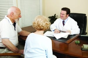 http://www.dreamstime.com/royalty-free-stock-photography-doctor-discussing-treatment-plan-image13080367