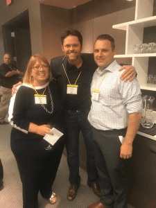 Justin Osmond of The Olive Osmond Foundation (center) takes a moment at the AUDNET Hearing Group Expo to visit with Deb Grant of AUDNET Hearing Group and Dr Lance Nelson of West Coast Hearing and Balance.