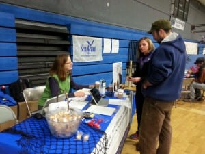 Alaska Sea Grant Marine Advisory agent Torie Baker speaks with fishermen in Cordova, Alaska, in 2015 about participating in a study about fishermen's health led by a University of Washington researcher Debra Cherry, MD.