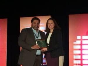 Amyn Amlani, PhD, is presented with the Joel Wernick Award by ADA President Alicia Spoor.