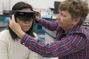 Anya Soberano, left, an electrical engineering technology major from St. Paul, Minn., works in the National Technical Institute for the Deaf's Center on Access Technology Lab alongside Wendy Dannels, research associate professor and principal investigator on the augmented reality project.