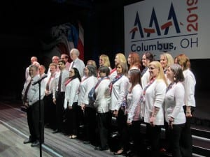 The all-audiologist AAA Choir, directed by David Speidel and organized by Bob DiSogra, started off the General Session with the National Anthem.
