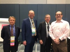 """Jay Hall, Ian Windmill, Barry Freeman, and healthcare actuarian Jason Freeman presented the feature session, """"Audiology and Medicare: Where Economic Reality Collides with Hearing Care."""""""