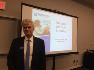Audioscan President Jim Jonkman gets ready to address the crowd at the company's annual breakfast for special equipment distributors on Thursday morning.