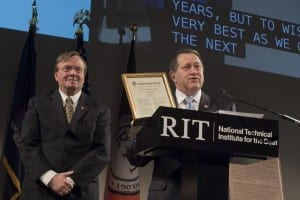 US Congressman Joseph Morelle, right, displays the Congressional Record announcement during the ceremony alongside NTID President Gerry Buckley. Credit: Mark Benjamin/NTID