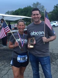 Oticon Regional Audiology Manager Pam Dorn, AuD and Oticon Government Services Director David Horowitz, AuD, display individual and team awards from the April 13 race.